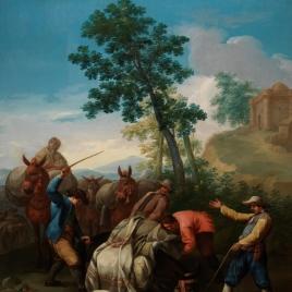 Un mulo caído con su carga y unos arrieros levantándolo